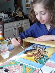 Sophie, age 7, painting Ethiopian folk art