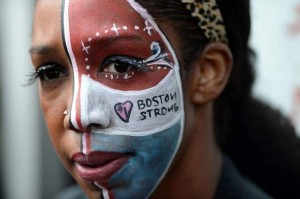 Apr 18, 2013; Boston, MA, USA; Lauren Mooney of Boston painted her face to show pride in Boston while waiting outside the Cathedral of the Holy Cross during an Interfaith Vigil in honor of the victims of the Boston Marathon bombings. Mandatory Credit: Michael Ivins-USA TODAY Sports / USA TODAY Sports