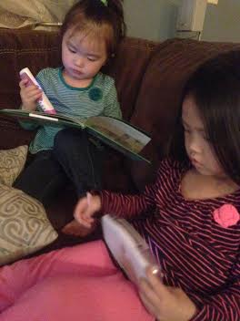 Anna and Grace playing with new Leap Frog gadgets from Aunt Beth and Uncle Kevin