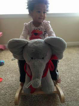 Gabby on her new rocking elephant