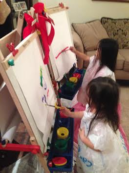 Anna and Grace painting on the easels Pops and Susu gave them