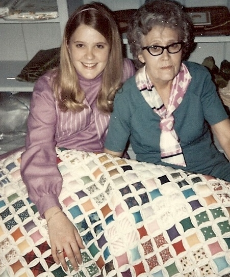 With Mamaw in June, 1970. She made my lavender dress and vest, the dress she's wearing, and the quilt.