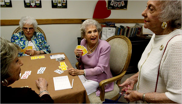 "Georgia Scott, 99, center, during a game of bridge at her retirement community. ""It's what keeps us going,"" she says. (Sandy Huffaker for the New York Times)"