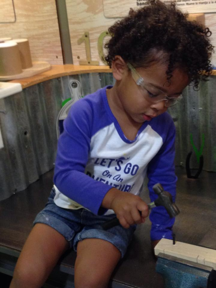 Gabby working with tools.