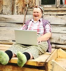 woman laughing w laptop