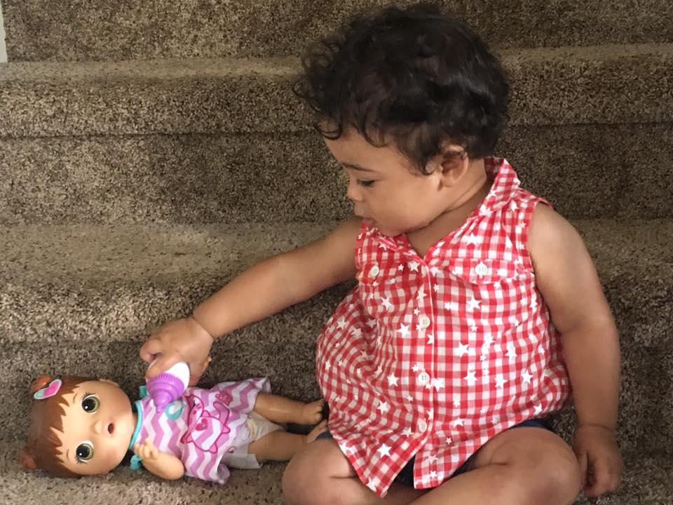 Izzy feeding doll