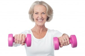 Older-woman-holding-weights