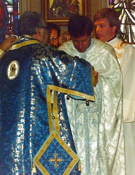 Bishop Antoun (left) and Father John Troy Mashburn (right) help Father Basil Cushman at his ordination on March 15, 1987.