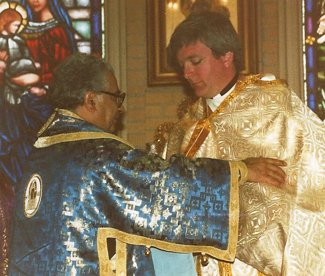 Bishop Antoun assists Father John Troy Mashburn during his ordination, March 15, 1987.