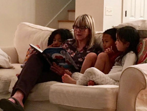 reading to my three oldest granddaughters at the beach last month