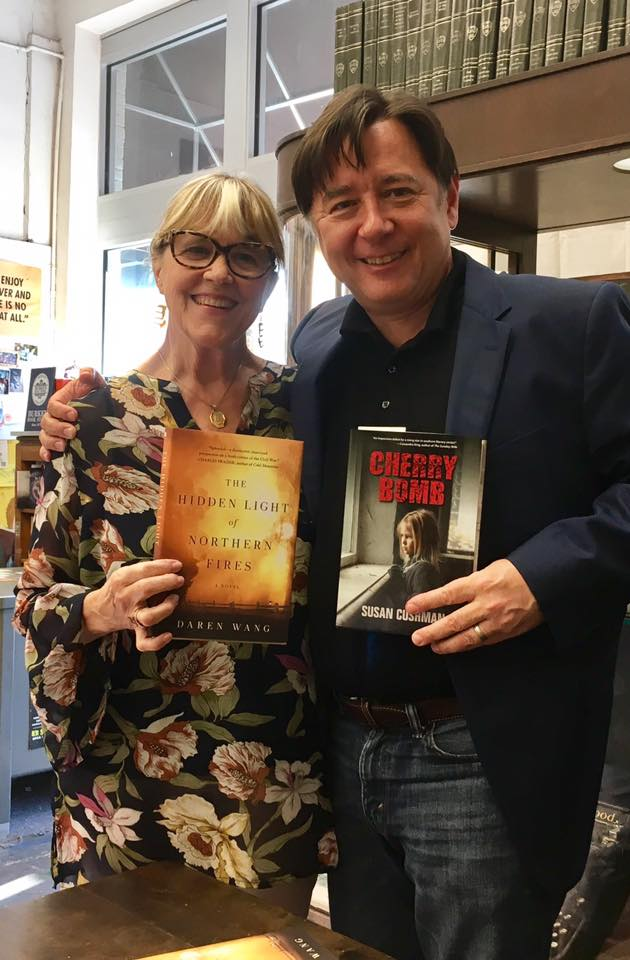 Exchanging first novels with Daren Wang at Burke's Books in Memphis on September 20.