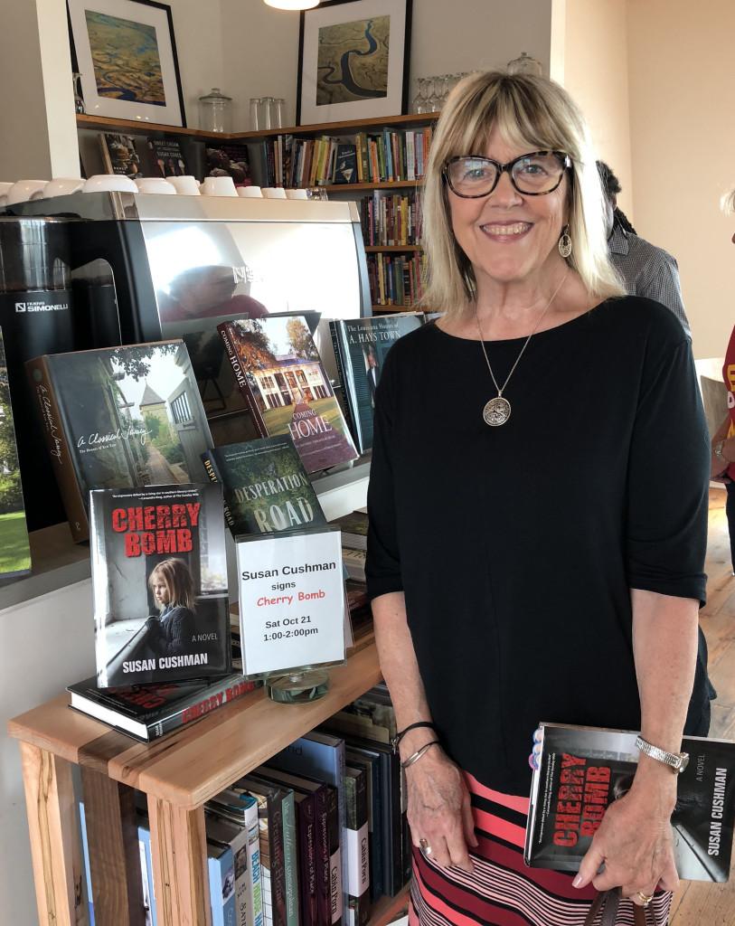 Susan at register Pass Books