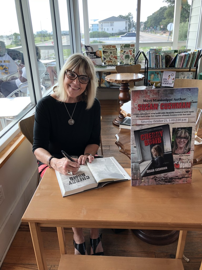 Susan signs Pass Books