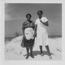 Lilly Bell in the apron, with another family's maid in Florida on our vacation in 1956.