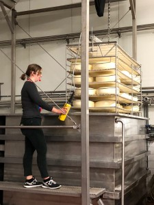 Desiree showing us how cheese is made.