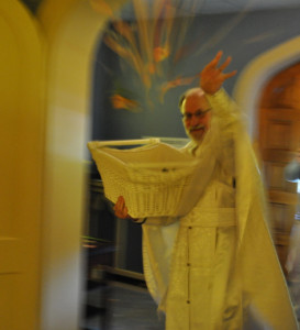 Father Basil (aka Bill Cushman) tossing rose petals and bay leaves during the Holy Saturday service at St. John Orthodox Church in Memphis