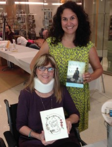 With Julie Cantrell at Bookfest 2013 at the Memphis Library in October, three months after the wreck. (in a wheelchair)