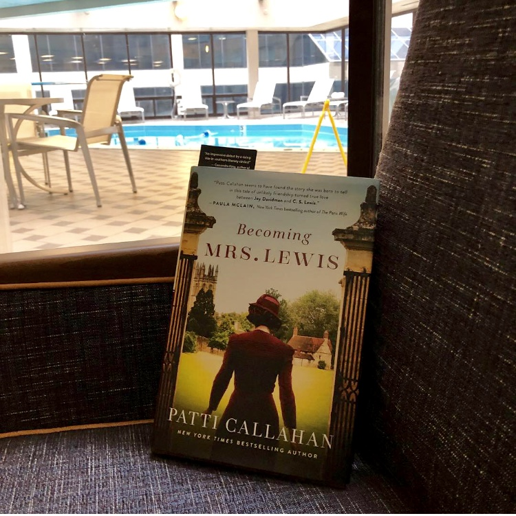 Reading Becoming Mrs. Lewis in my hotel room in Nashville, with the indoor pool outside my window!