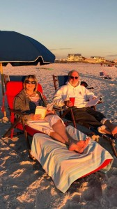 Reading CONGRATULATIONS, WHO ARE YOU AGAIN? at Seagrove Beach on Thanksgiving Day, with my husband, Bill.