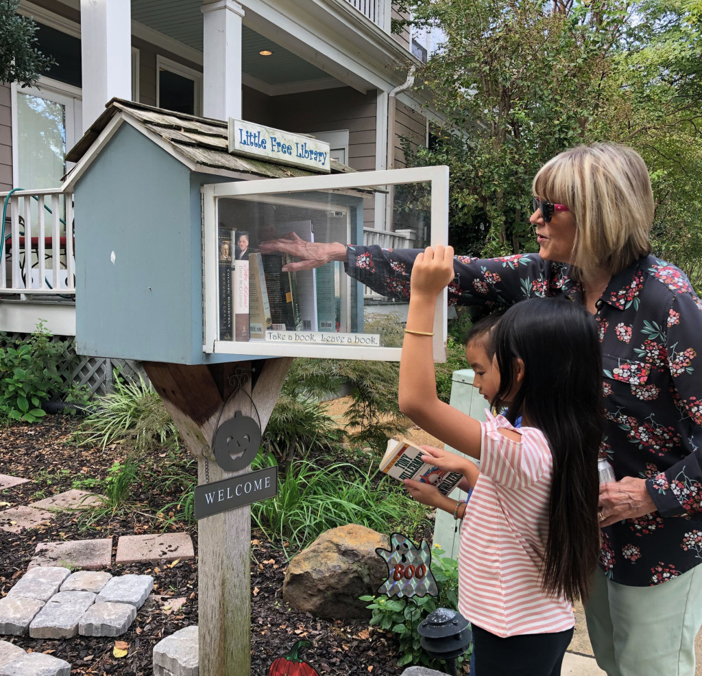 Grace, Anna, and SuSu visit one of the two Little Free Libraries in our neighborhood.