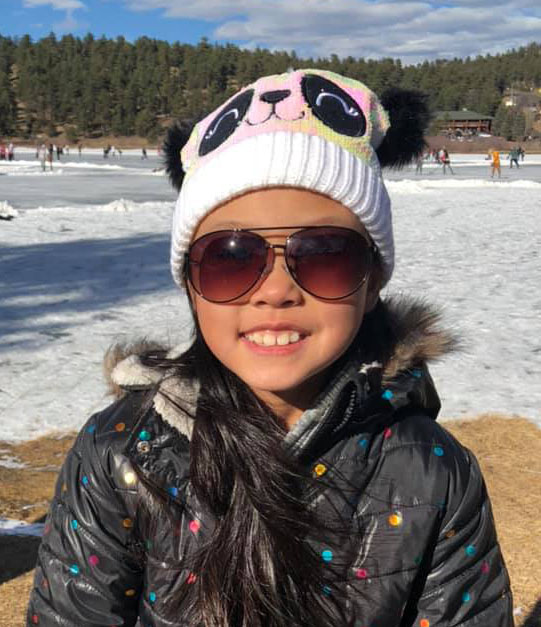 Grace on a frozen lake near her house outside Denver